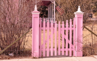Pink fence representing prevention as a part of our health and wellness strategy.