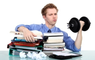 young man with documents and dumbbell